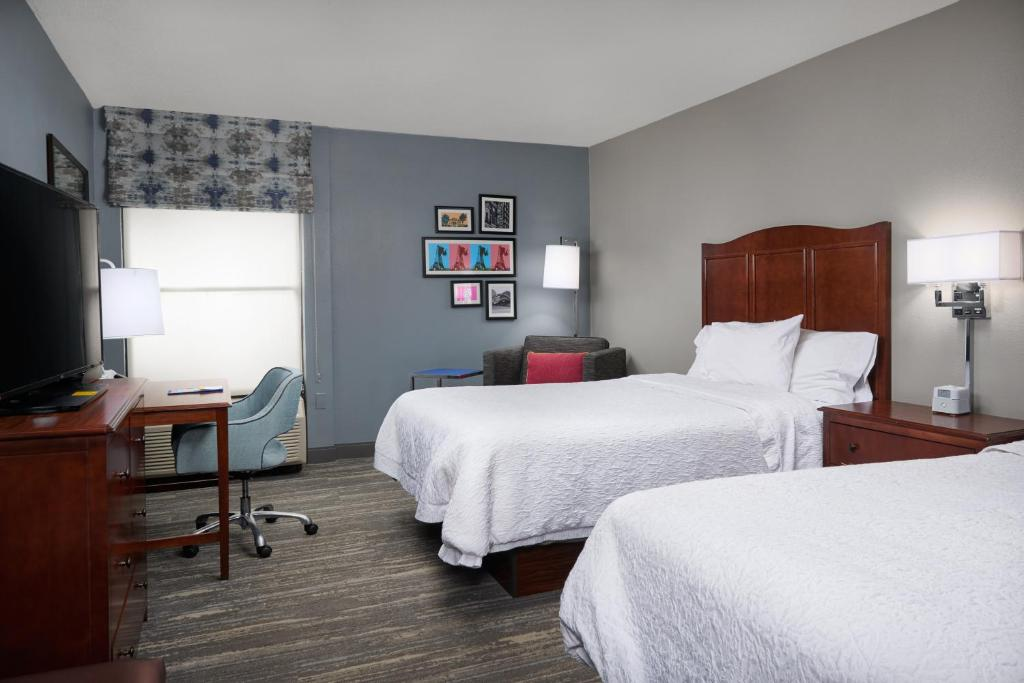 A bed or beds in a room at Hampton Inn Beaumont
