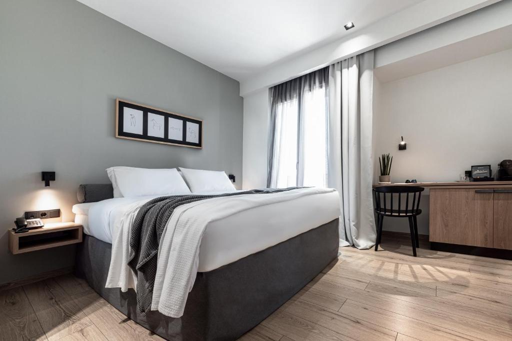 A bed or beds in a room at 31 Doors Hotel