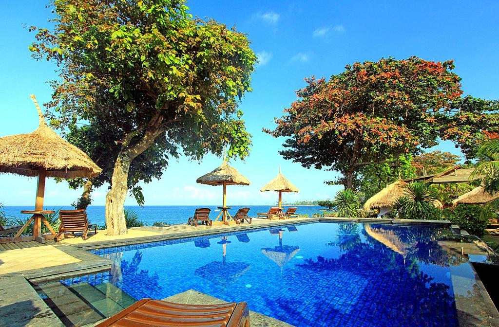 The swimming pool at or near Sunsethouse Lombok