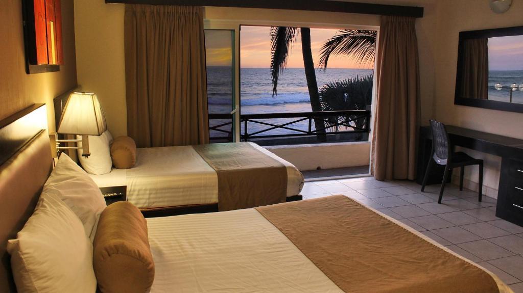 Cama o camas de una habitación en Hotel La Siesta