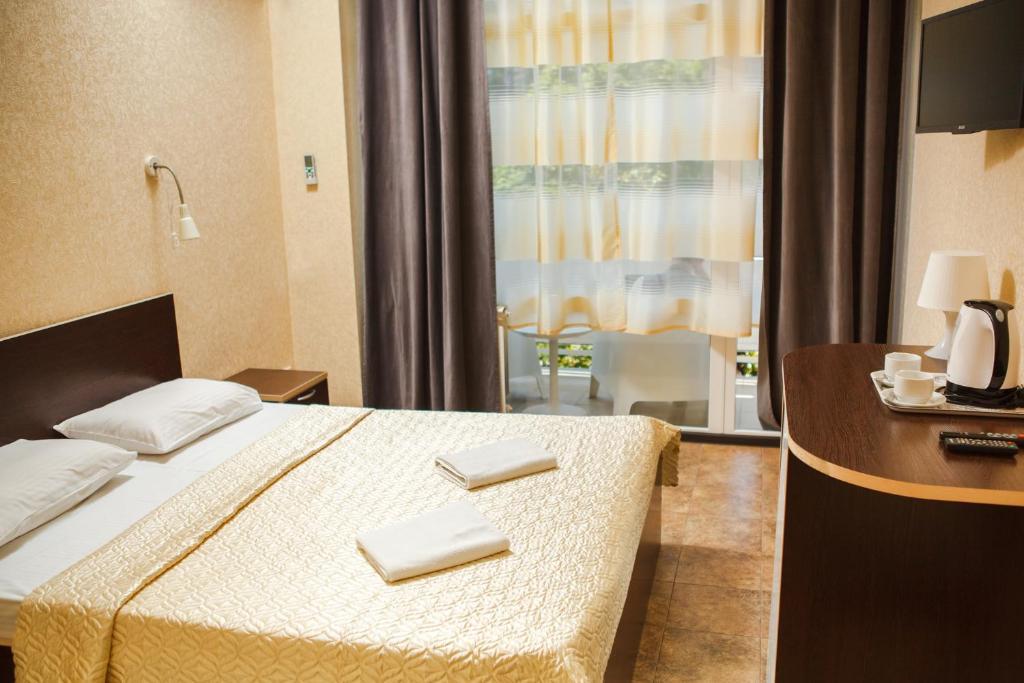 Кровать или кровати в номере Суббота Апартаменты