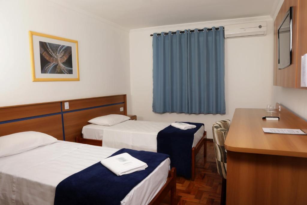 Cama ou camas em um quarto em Hotel Modena - São José dos Campos