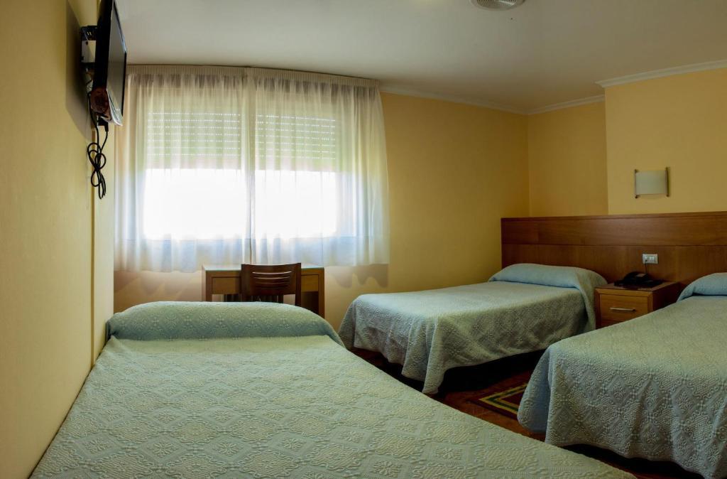 Cama o camas de una habitación en Hotel Mabú