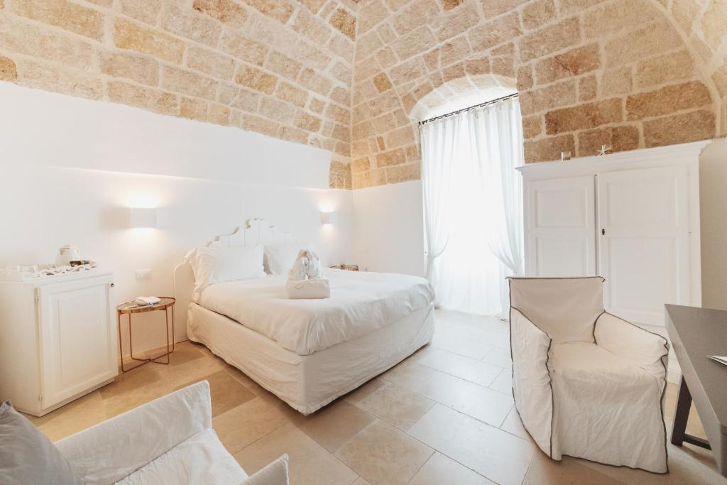 A bed or beds in a room at Giovì Relais