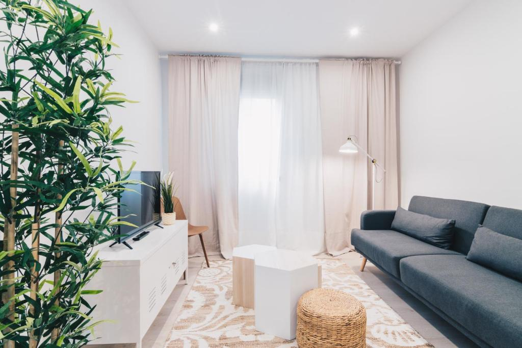 A seating area at Altair apartment by People Rentals