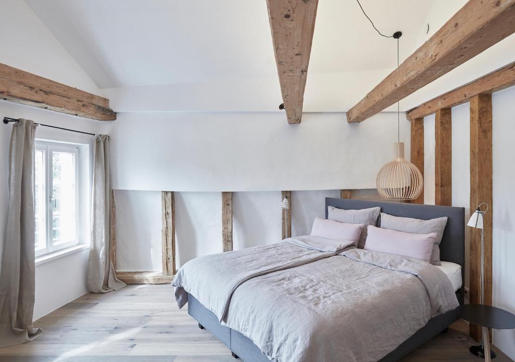 Ein Bett oder Betten in einem Zimmer der Unterkunft Faktorei