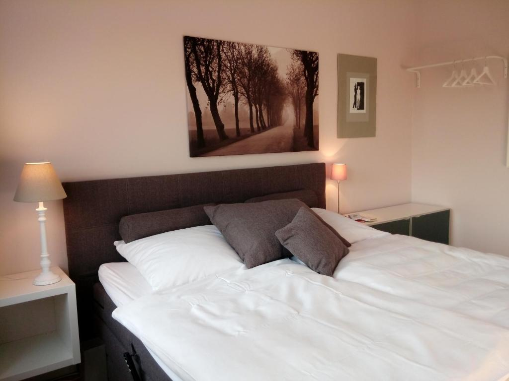 A bed or beds in a room at Ferienwohnung Linsenstrasse 13