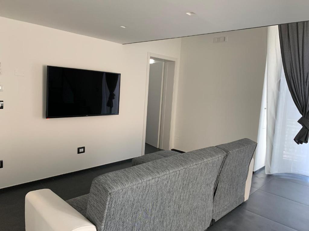 TV o dispositivi per l'intrattenimento presso Little Dreams Apartment