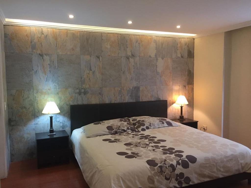 A bed or beds in a room at Fontana: Location + Pool