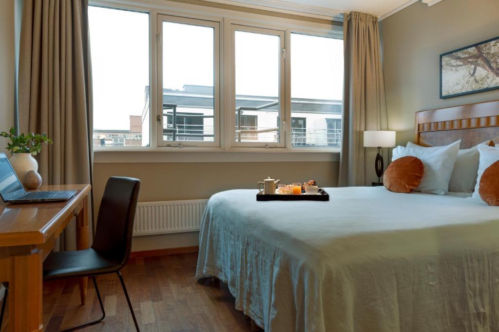 En eller flere senge i et værelse på First Hotel Millennium