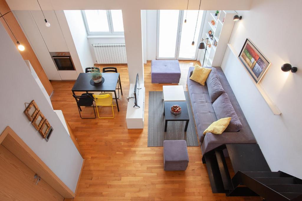 Ein Sitzbereich in der Unterkunft Urban Serviced Apartments
