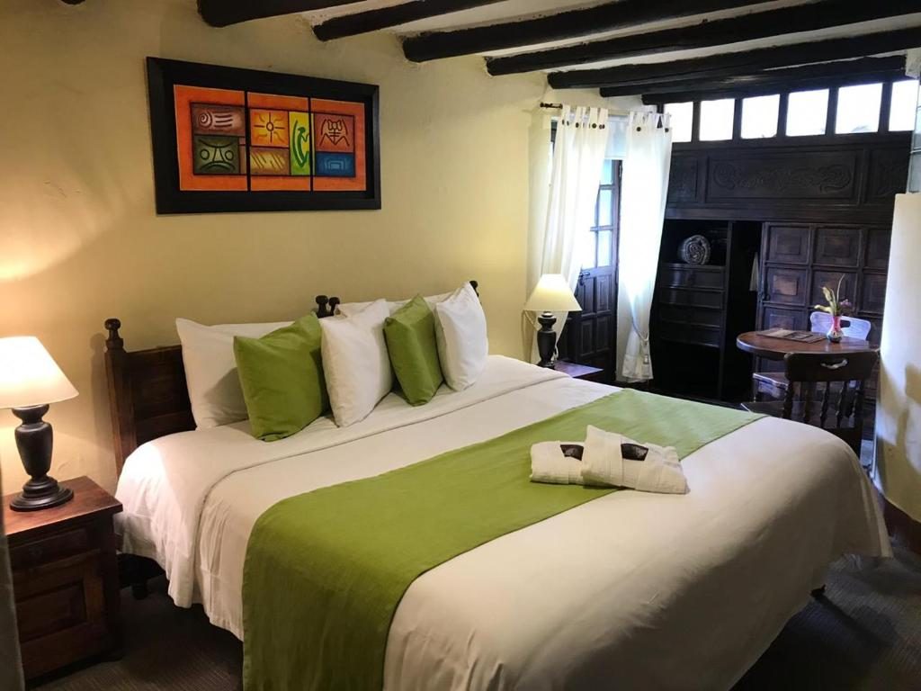 A bed or beds in a room at Hotel Hacienda El Salitre