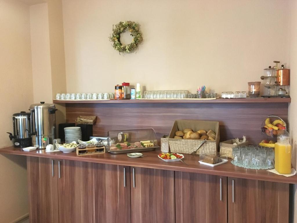 Ein Restaurant oder anderes Speiselokal in der Unterkunft Pension No. 55