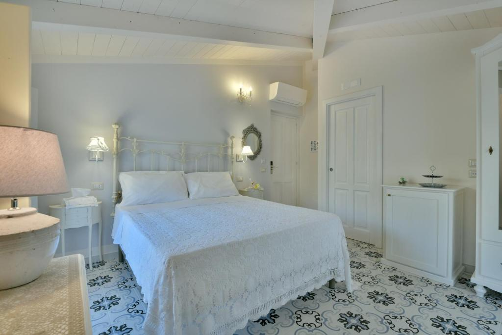 A bed or beds in a room at A casa di Nonna Bianca