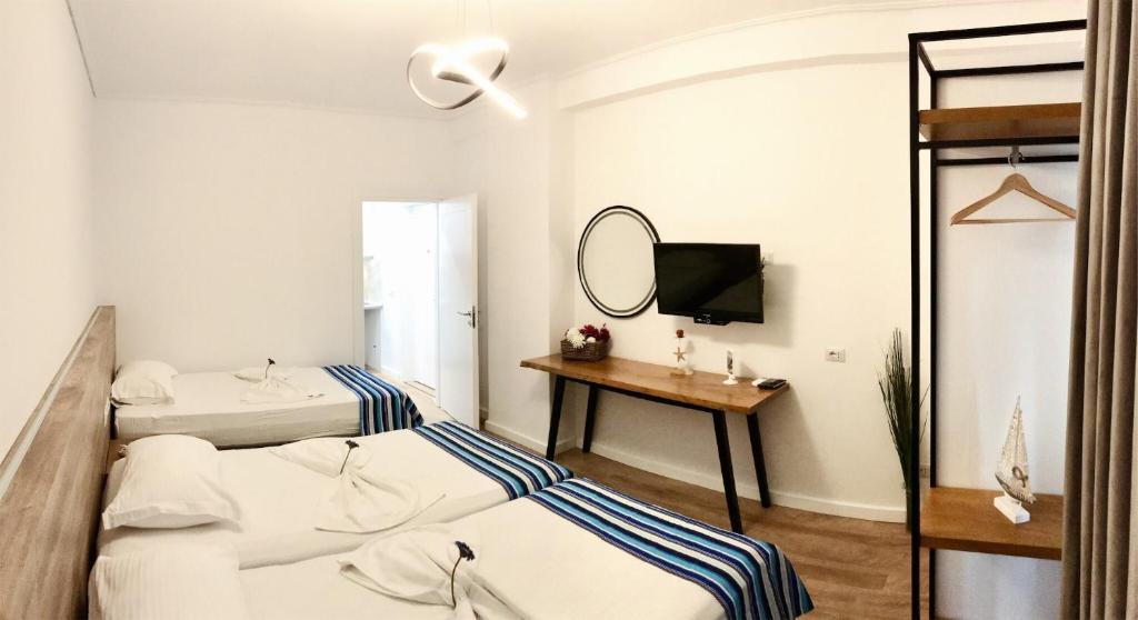 Апартаменты-студио с боковым видом на пляж: фотография номер 3