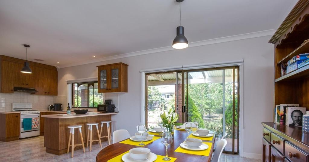 A kitchen or kitchenette at National Park & Ocean Retreat
