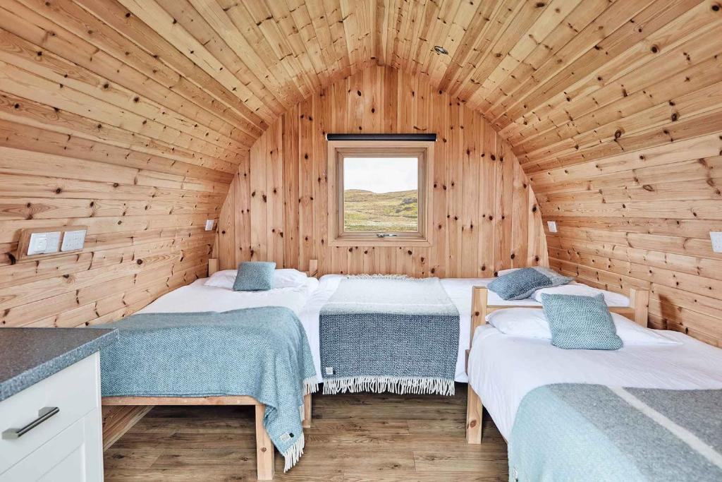 A bed or beds in a room at Iona Pods