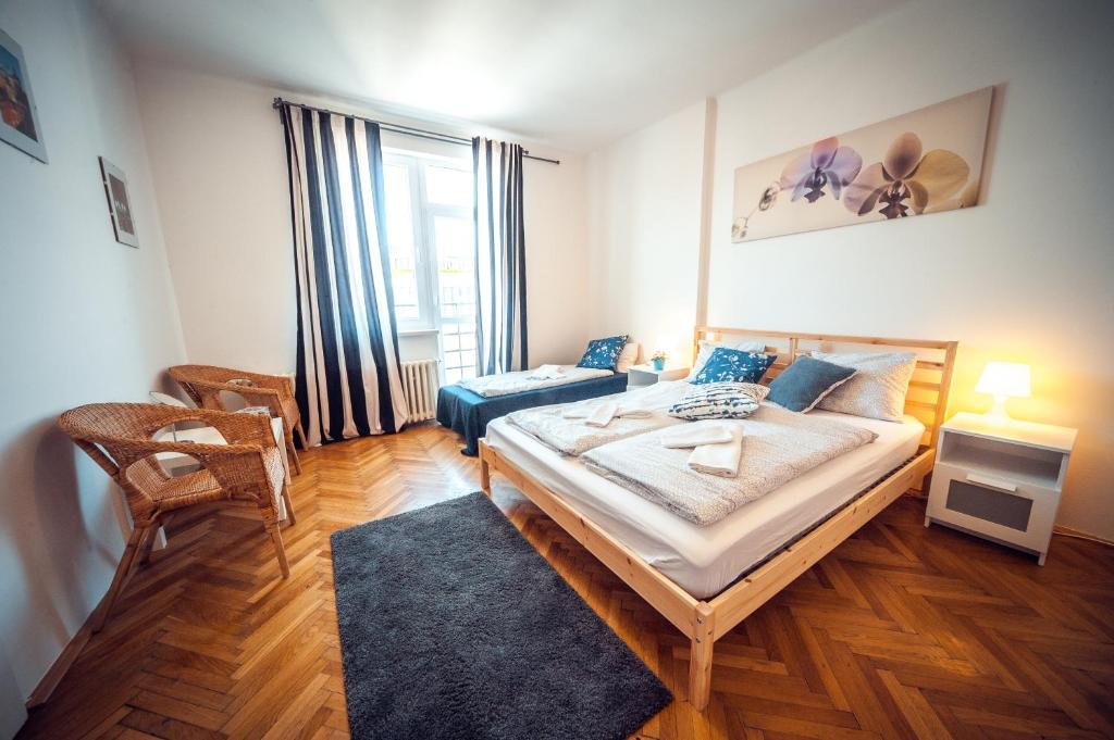 A bed or beds in a room at Residence Karlinium with Large Terrace