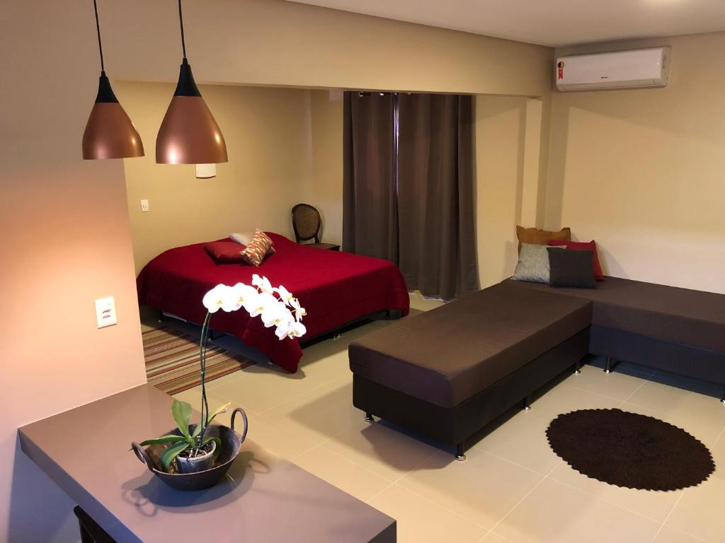 A bed or beds in a room at Casa do Lago