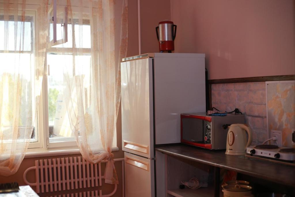 Кухня или мини-кухня в Уютная квартира