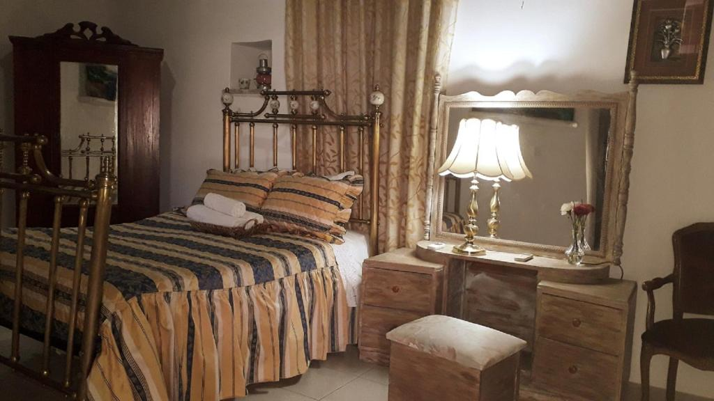 A bed or beds in a room at Lefkara View