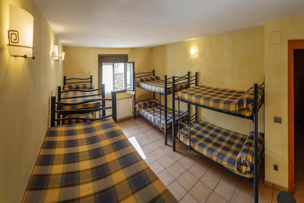 A bunk bed or bunk beds in a room at ALBERGUE SAN SATURNINO