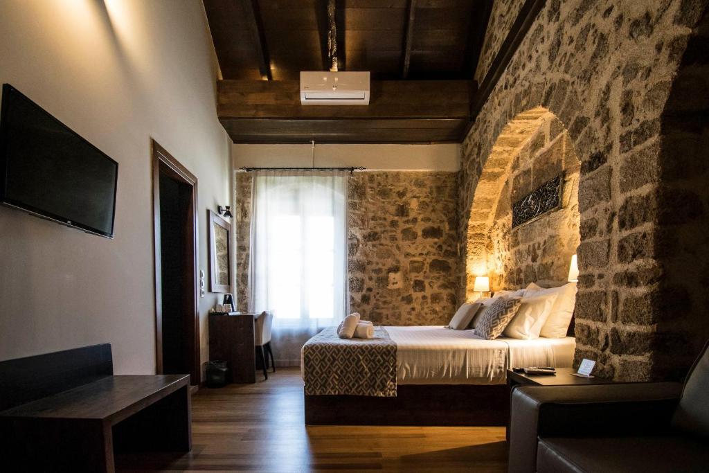En eller flere senger på et rom på D'Argento Boutique Rooms