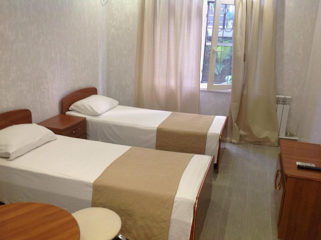 Кровать или кровати в номере Гостевой дом «Палуба»