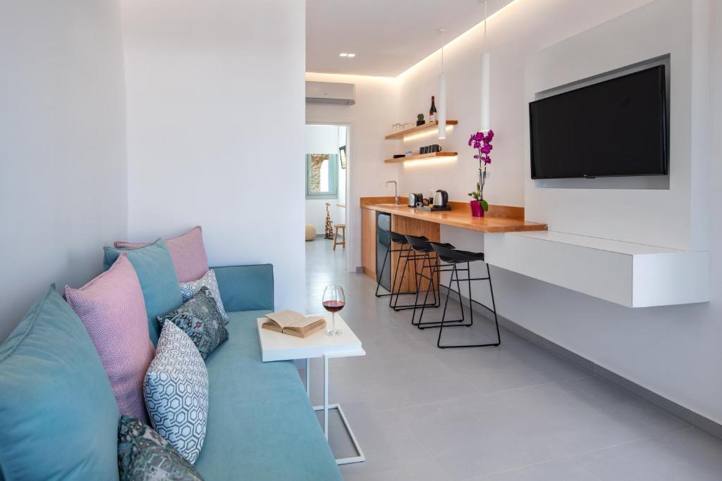 Area soggiorno di Harmony Suites