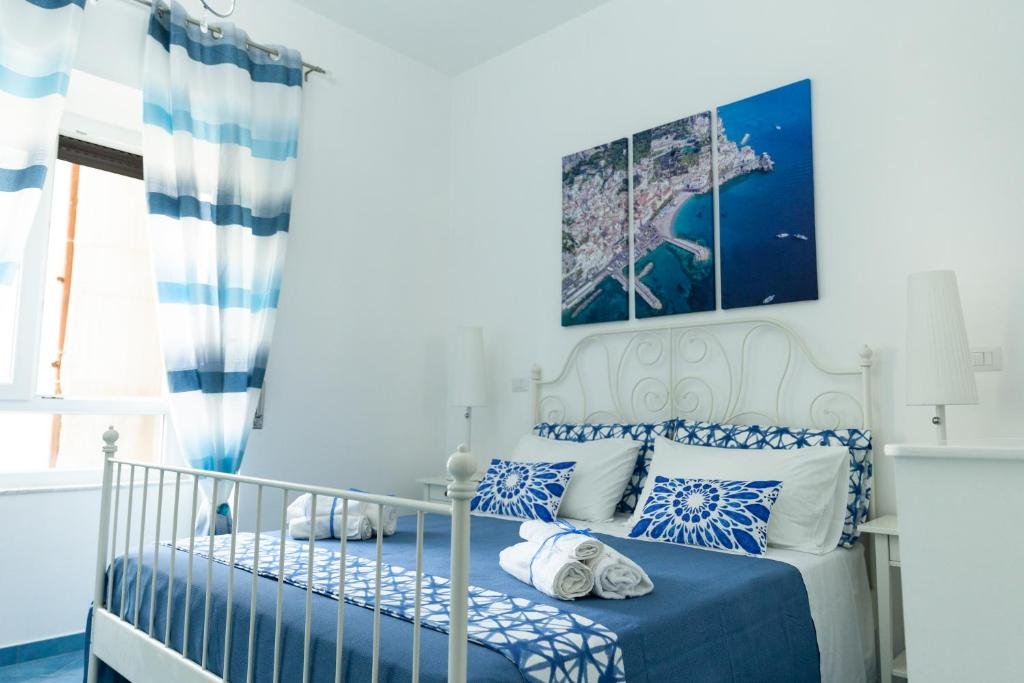 A bed or beds in a room at Velia34