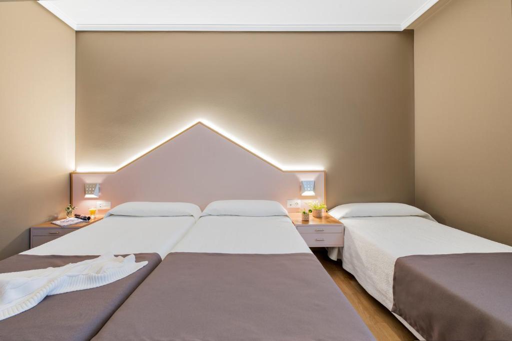 A bed or beds in a room at La Casa del Patrón