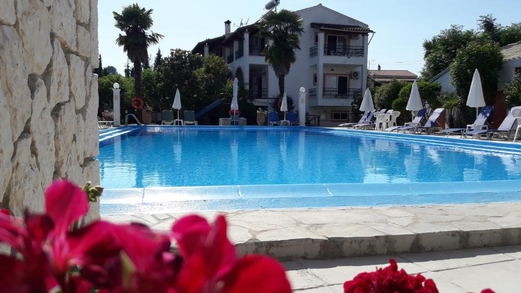 The swimming pool at or near Angela Hotel & Apartments