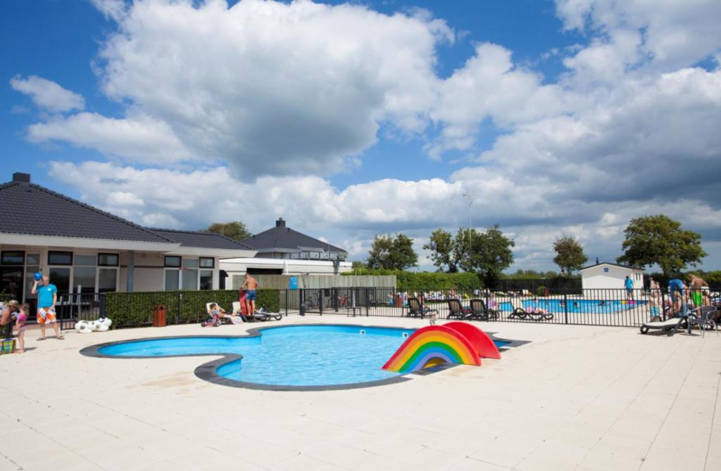 The swimming pool at or near WH Comfort 3 personen
