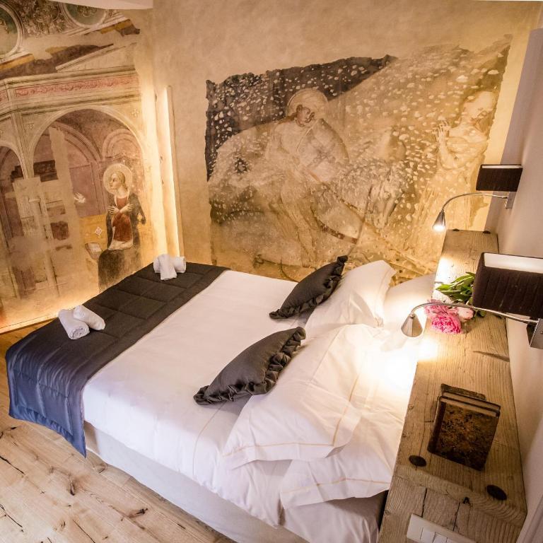 Letto o letti in una camera di San Pier Novello in Oltrarno