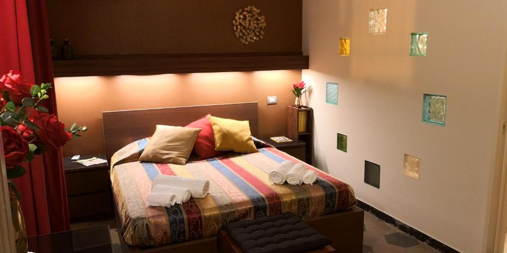A bed or beds in a room at Casa Vacanze Archi Medievali
