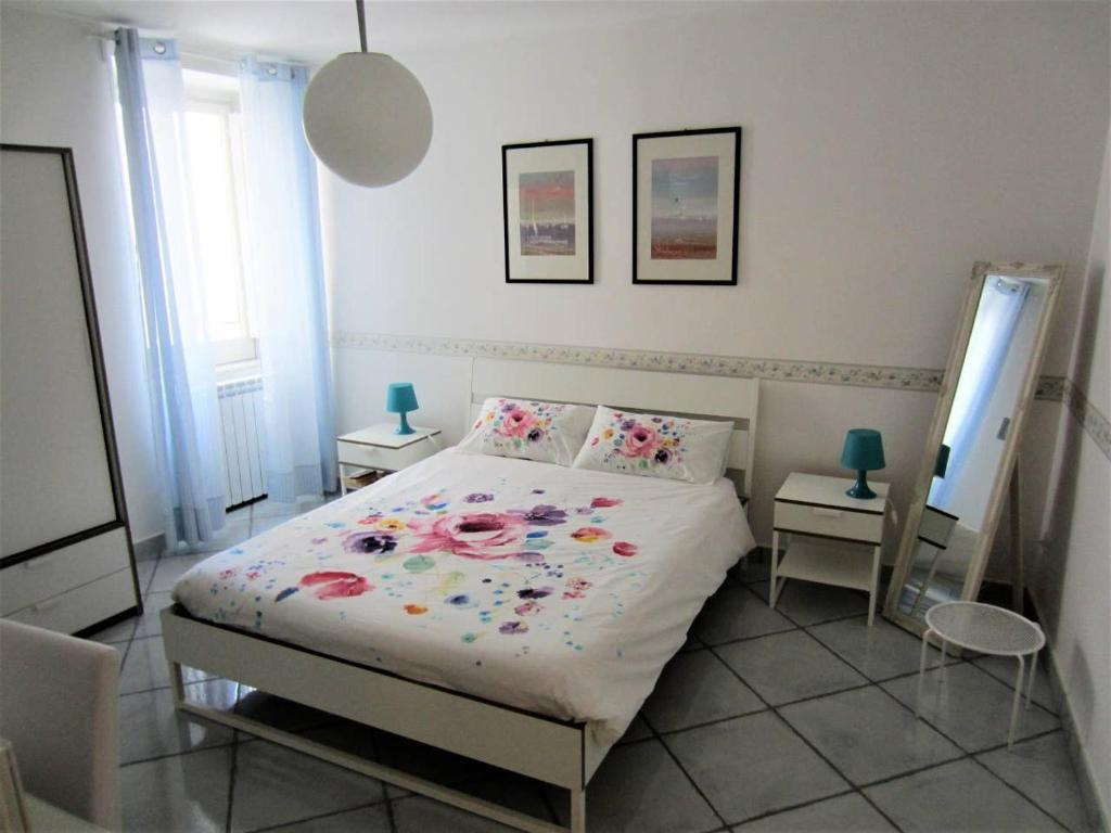 A bed or beds in a room at Al Piccolo Mercante