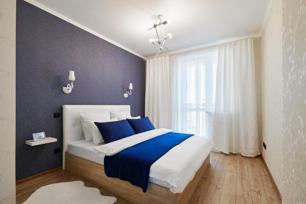 A bed or beds in a room at PaulMarie Apartments on Mayakovskogo 35