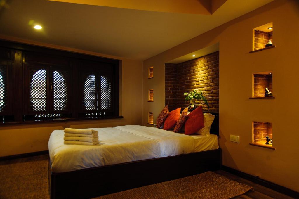 Cama o camas de una habitación en Thagu Chhen, a Boutique Hotel