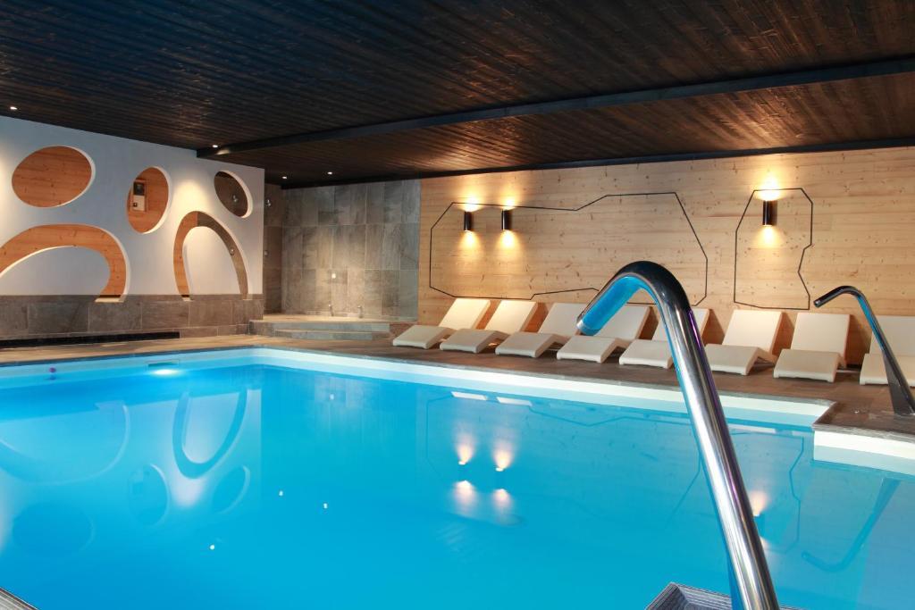 The swimming pool at or near Hotel de la Jamagne & Spa