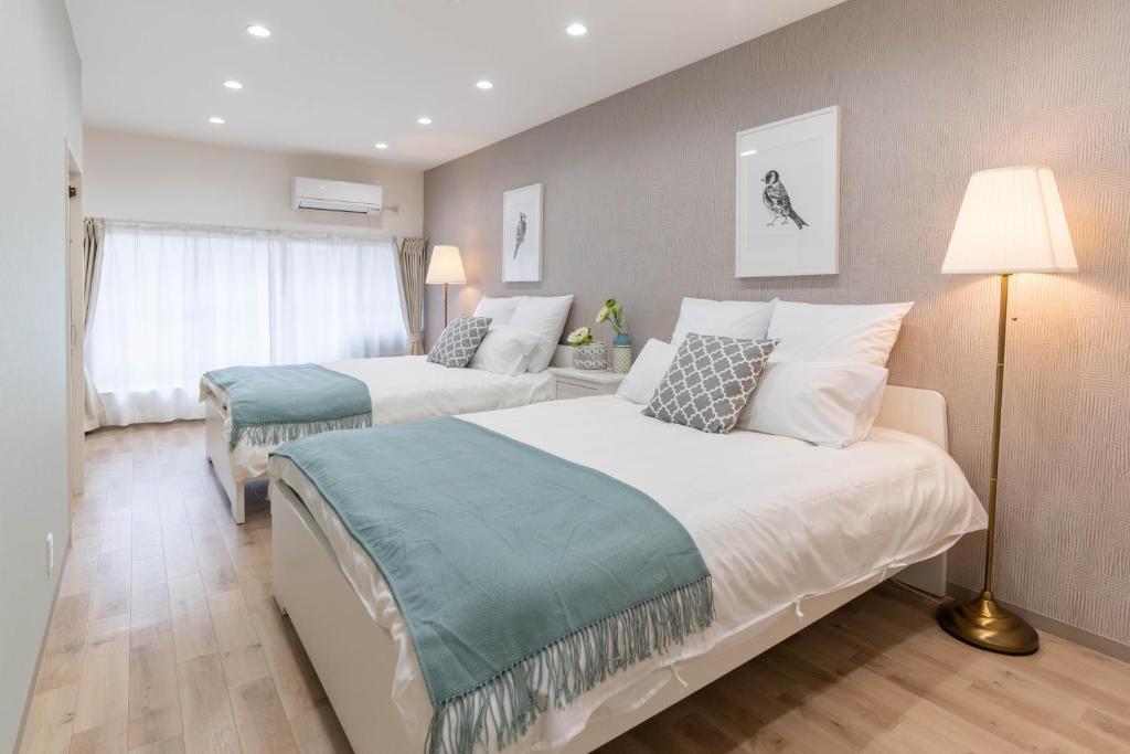 Bijou Suites Cyanにあるベッド