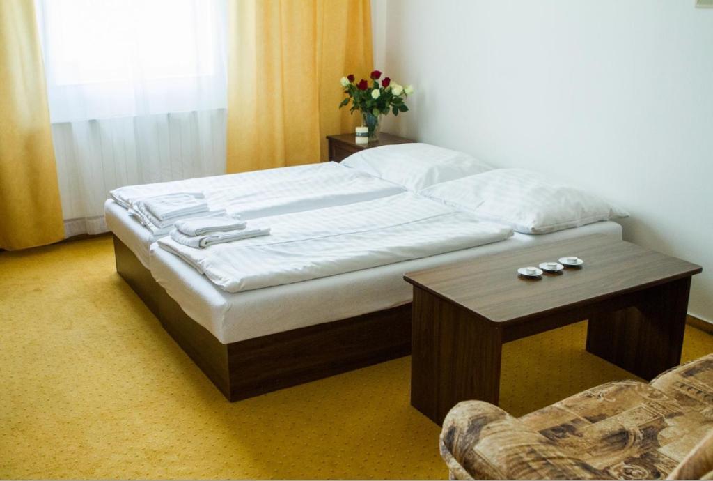 Postel nebo postele na pokoji v ubytování Penzion Pomnenka