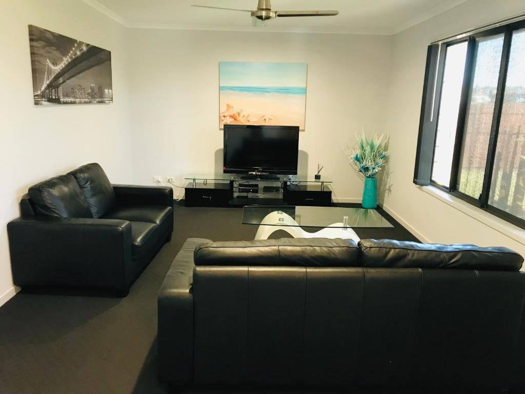 A seating area at Hervey Bay Holiday Home