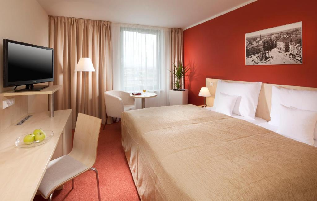 A bed or beds in a room at Clarion Congress Hotel Olomouc