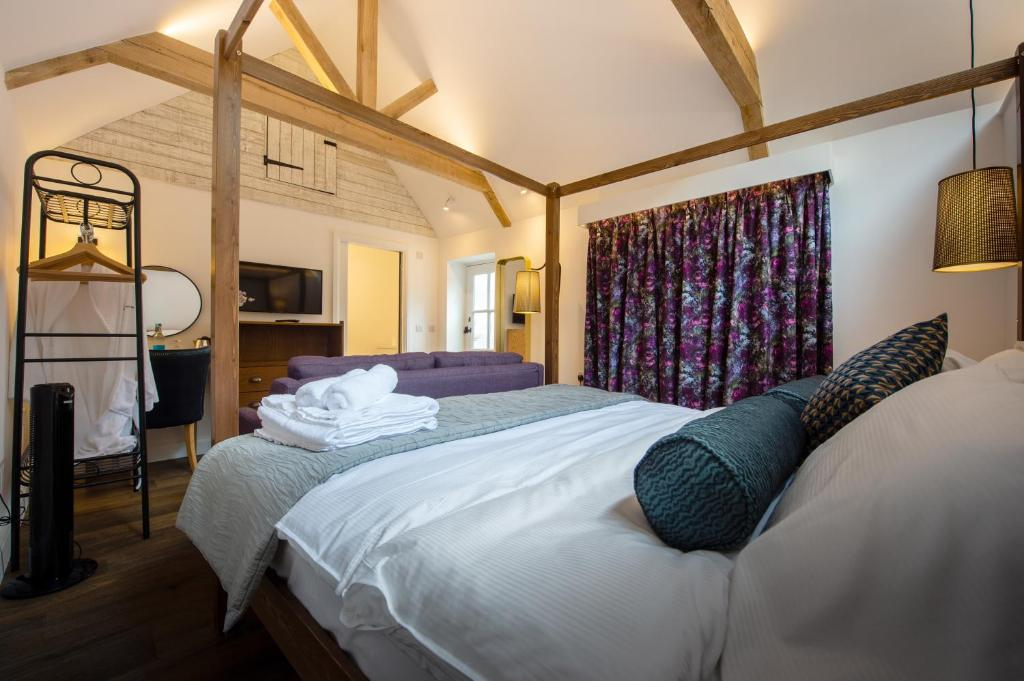 A bed or beds in a room at The Withies Inn