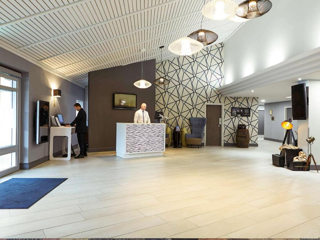 The lobby or reception area at Novotel Manchester West