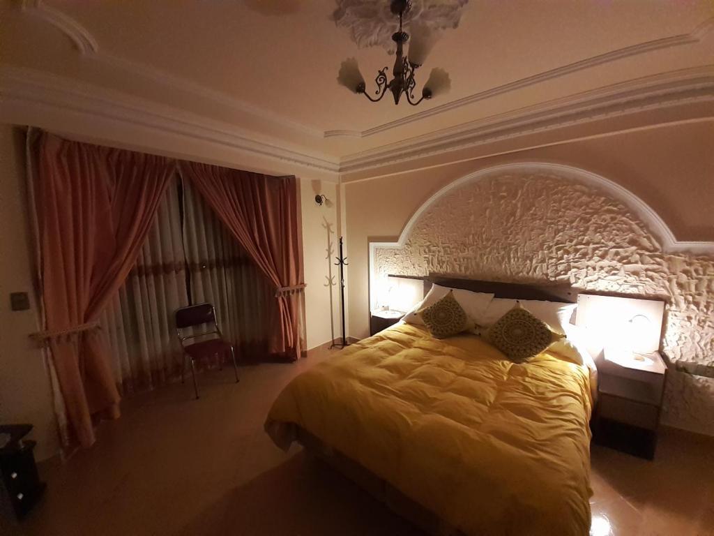 Cama o camas de una habitación en Bonito apartamento familiar