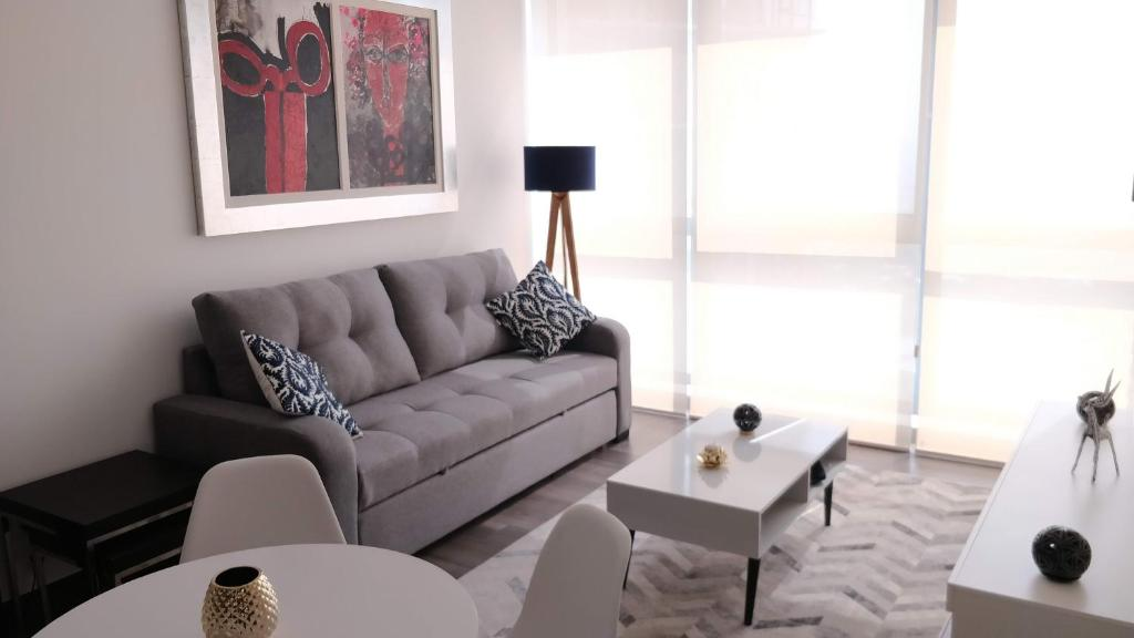 A seating area at Minimalistic and modern decore 1B apartment Polanco
