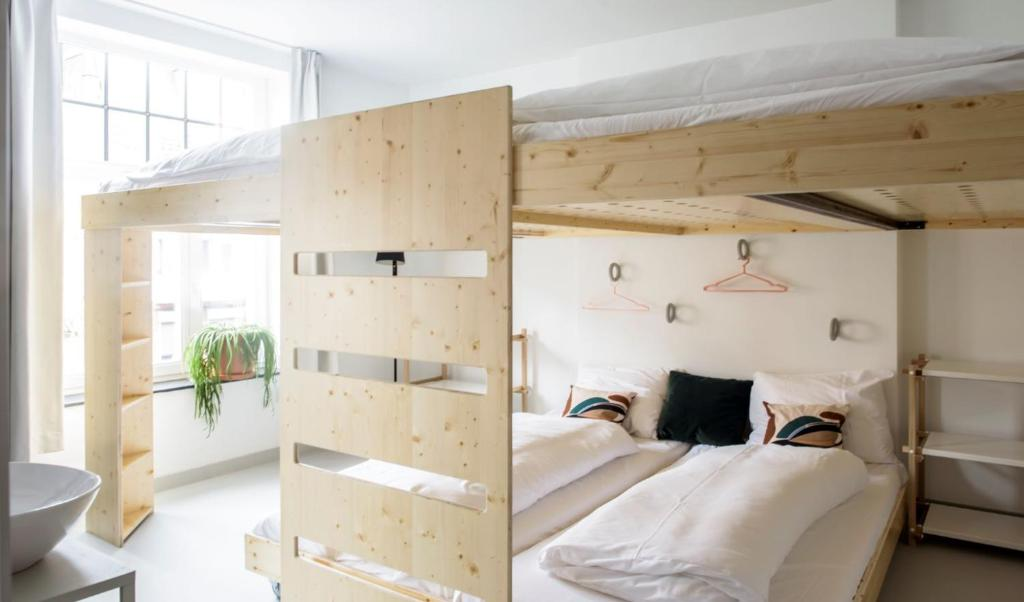 A bunk bed or bunk beds in a room at The Green Elephant Hostel & Spa