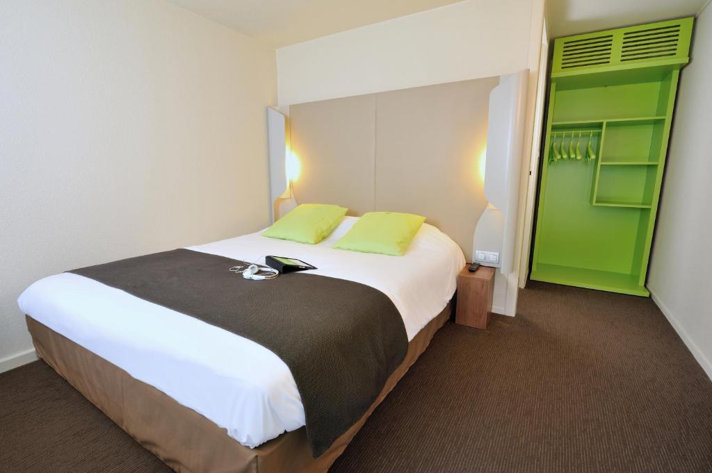 Un ou plusieurs lits dans un hébergement de l'établissement Campanile Lorient - Lanester
