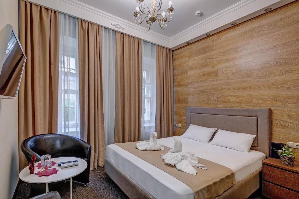 Кровать или кровати в номере Отель На Таганке